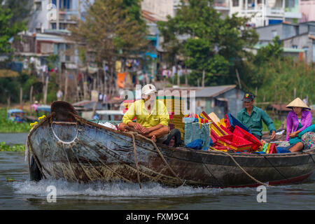 Asian man yawning - Life on the Mekong River gets tiring for people at work on the boats, Chau Doc, Vietnam - Stock Photo