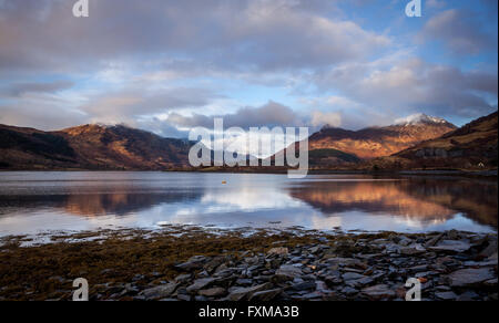 The last of the evening light hitting the side of the Pap of Glencoe. - Stock Photo