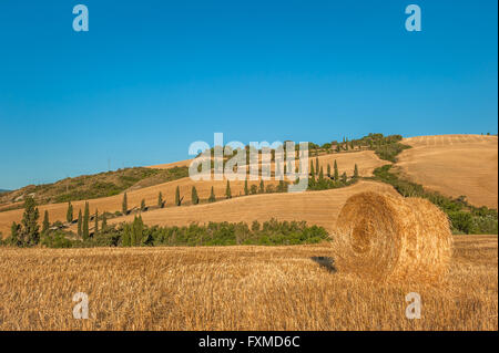 Tuscany landscape with hay bales in the field, Italy - Stock Photo