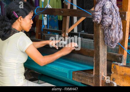 Woman Weaving on Loom, Ubud, Bali, Indonesia - Stock Photo
