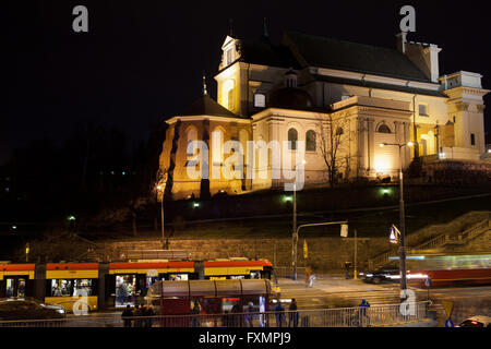 St. Anne's Church at night in Warsaw, Poland, tram on Solidarity Avenue - Stock Photo