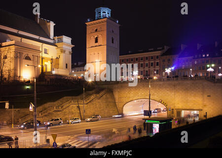 City of Warsaw by night in Poland, tunnel under Old Town, Solidarity Avenue (Aleja Solidarnosci), street, on left - Stock Photo
