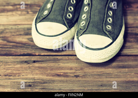 sneakers on wooden deck. - Stock Photo