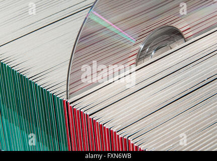 CDs or DVDs in colorful paper sleeves - Stock Photo