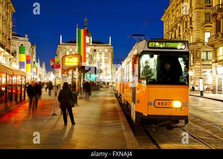 MILAN, ITALY - NOVEMBER 24: Via Dante shopping street with people at night on November 24, 2015 in Milan, Italy. - Stock Photo