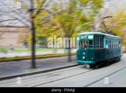 MILAN, ITALY - NOVEMBER 25: Old tram at Piazza Castello on November 25, 2015 in Milan, Italy. - Stock Photo