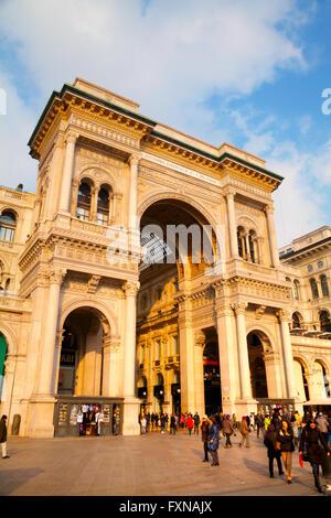 MILAN, ITALY - NOVEMBER 25: Galleria Vittorio Emanuele II shopping mall entrance with people on November 25, 2015 - Stock Photo