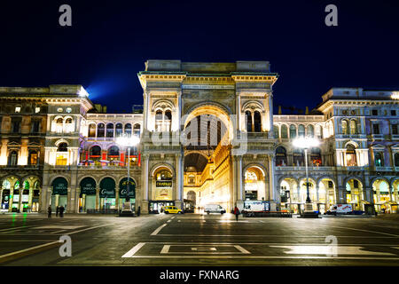 MILAN, ITALY - NOVEMBER 25: Galleria Vittorio Emanuele II shopping mall entrance with people early in the morning - Stock Photo
