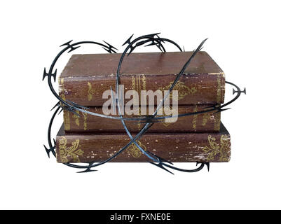 Sharp razor wired used as a barrier around old books - Stock Photo