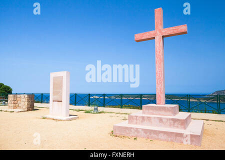 Red stone cross near the Saint Spiridon church on the French Mediterranean island of Corsica. Corse-du-Sud department - Stock Photo