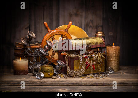 Composition of treasure chest on wooden background - Stock Photo