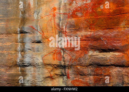Aboriginal rock art of dancing at In, at Burrunggui (Nourlangie Rock), Kakadu National Park, Northern Territory, - Stock Photo