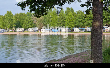 RAUMA, FINLAND ON JULY 01, 2013. View of Camping grounds along the seaside. Caravans and Campers. Unidentified people. - Stock Photo