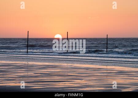 Sunset on the North Sea coast, Wangerooge, East Frisian Island, East Frisia, Lower Saxony, Germany - Stock Photo