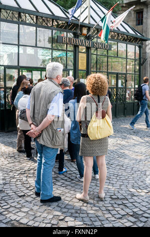A line of tourists queue at the funicular terminal at the foot of Castle Hill on the Buda side of Budapest in Hungary. - Stock Photo