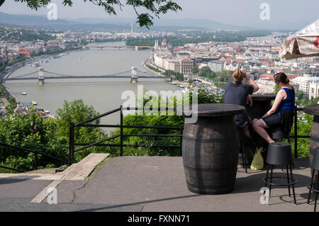 Visitors admiring the view from the citadel on Gellert Hill of the River Danube on the Buda side of Budapest in - Stock Photo