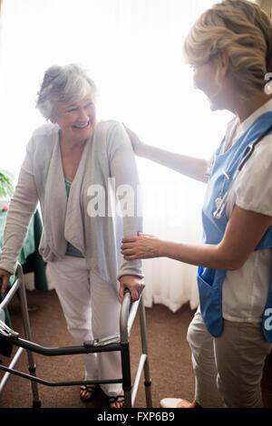 Nurse taking care of a senior woman - Stock Photo