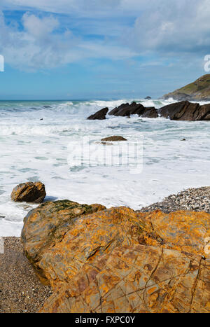 Waves hitting dollar cove beach near Gunwalloe on the Lizard Coast Cornwall - Stock Photo