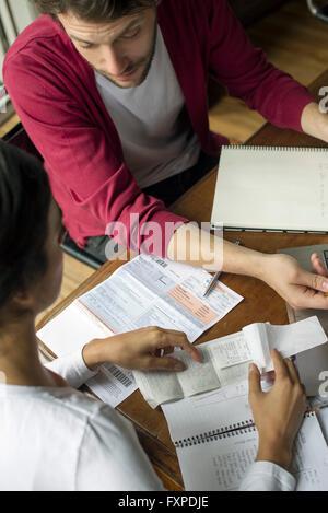 Couple organzing household finances - Stock Photo