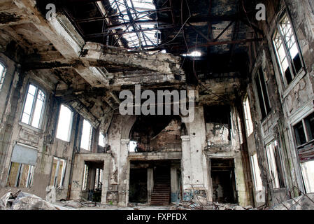 Interior of abandoned building destroyed by fire - Stock Photo