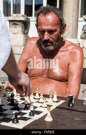 A game of chess  being played at the Szechenyi Spa and Swimming pool in City Park, Budapest,Hungary - Stock Photo
