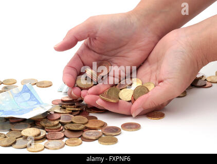 Hands filled with coins - Stock Photo