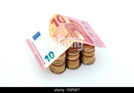 A house made of euro coins and a ten euro bill - Stock Photo