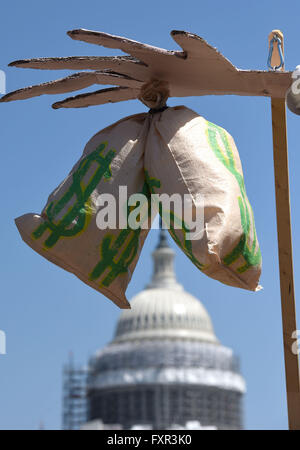 Washington, DC, USA. 17th Apr, 2016. 'Bags of money' are seen in front of the Capitol during a rally against Money - Stock Photo