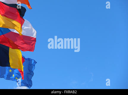 Strasbourg, France. 12th Apr, 2016. The national flags of the European Union member states sway in the wind attached to flag poles in front of the European parliament building in Strasbourg, France, 12 April 2016. Photo: Karl-Josef Hildenbrand/dpa/Alamy Live News