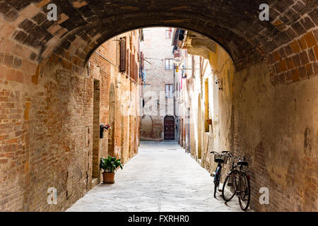 View of a typical alley in Buonconvento - Stock Photo