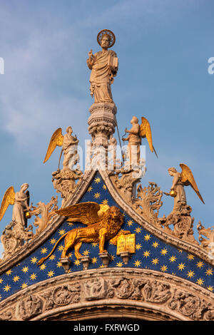 San Marco Cathedral, Venice, detail of the facade. St Mark with angels above the Winged Lion, symbol of Venice and - Stock Photo