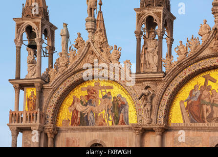 Saint Mark's Basilica Cathedral, Venice, detail of the facade facing San Marco Square. Mosaic The Deposition from - Stock Photo
