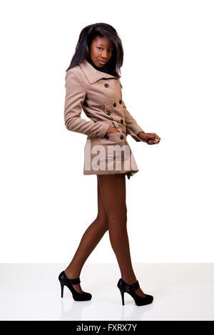 Young Black Woman Standing Coat Heels Legs - Stock Photo