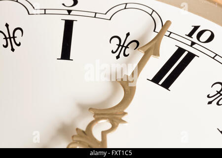 Clock Hand Close Up with Roman Numerals - Stock Photo