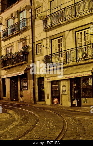 Alfama quarter at night in Lisbon, Portugal - Stock Photo