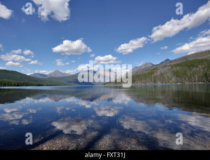 Clouds reflected in Kintla Lake, Glacier National Park, Montana, USA - Stock Photo