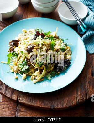High angle view of mushroom and celery salad on blue plate - Stock Photo