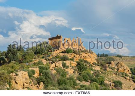 Temple of Juno on rugged hill, Valley of the Temples, Agrigento, Sicily, Italy - Stock Photo