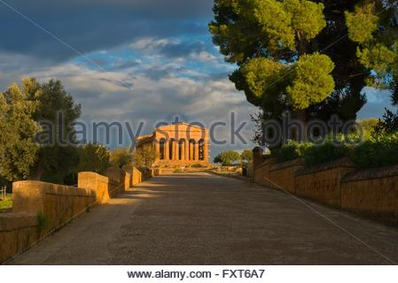 Walkway and Temple of Concordia, Valley of the Temples, Agrigento, Sicily, Italy - Stock Photo