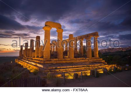 Floodlit Temple of Juno at dusk, Valley of the Temples, Agrigento, Sicily, Italy - Stock Photo