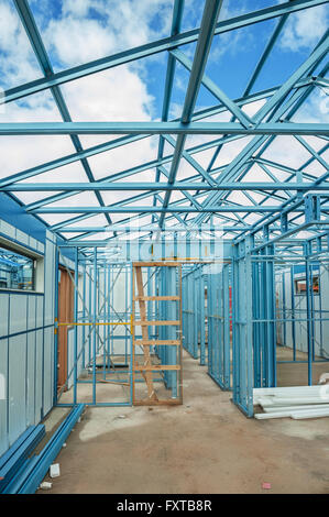 industrial building currently under construction using steel frames - Stock Photo