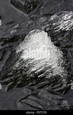 melting ice on lake, Finland - Stock Photo