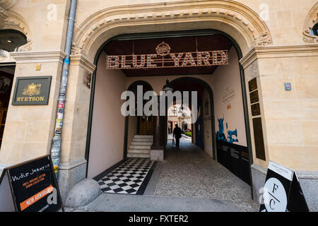 Entrance to Blue Yard courtyard containing cafes and fashion boutiques and shops in Mitte Berlin Germany - Stock Photo