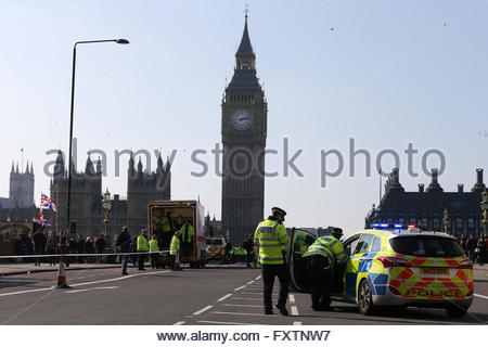 Metropolitan Police stand on Westminster Bridge with Big Ben, the Elizabeth Tower, in the background. London. March - Stock Photo