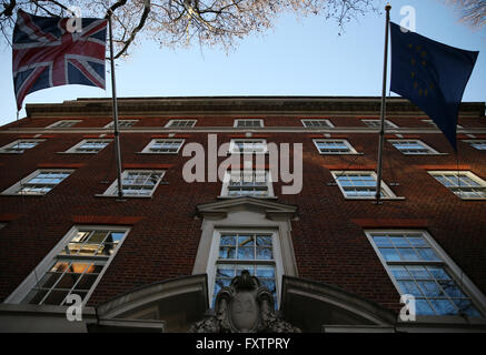 A British Union flag, AKA Union Jack, flies with the European Union (EU) flag, are seen outside Europa House. London, - Stock Photo