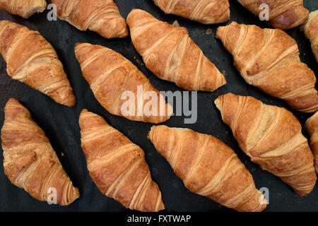 Fresh French croissants on the market - Stock Photo