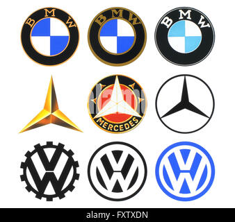 Kiev, Ukraine - March 16, 2016: Collection of retro car logos printed on white paper: Volkswagen, BMW and Mercedes - Stock Photo