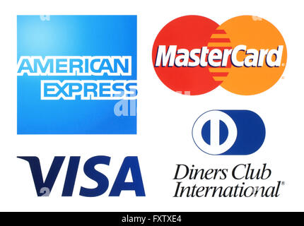 Kiev, Ukraine - April 04, 2016: Collection of popular payment system logos printed on white paper: American Express, - Stock Photo