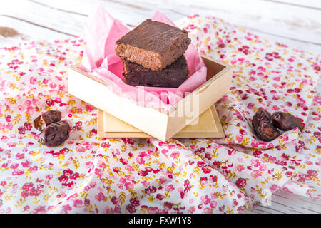Healthy gluten free Paleo style brownies made with sweet potato, dates and almond flour in a wooden box - Stock Photo