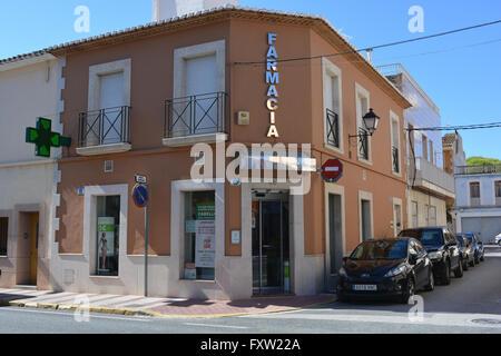A Spanish farmacia.  Pharmacy exterior with a green cross outside, Gata de Gorgos, Valencia, Spain - Stock Photo